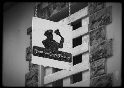 Hanging Johntown Crier Press Logo